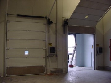 Torsion drive sectional doors two